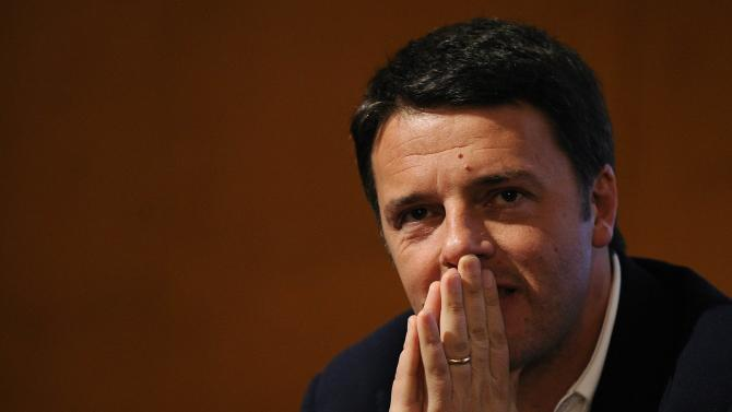Florence mayor Matteo Renzi looks on during a political meeting in Turin
