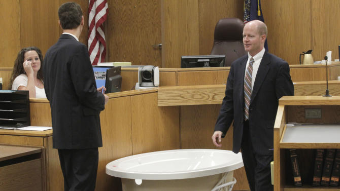 Defense attorney Randy Spencer, left, and Prosecuter Chad Grunander check out bathtub put in place in Judge Derek Pullan's 4th Distirct Courtroom during the trial of Martin MacNeill on Friday Oct. 18, 2013. MacNeill, a former Utah doctor, is accused of killing his wife, Michele, after convincing her to get a face-lift, giving her a lethal combination of prescription drugs for recovery and then helping her into the bathtub. The trial is resuming for a second day, with testimony from a dispatcher, police, paramedics and neighbors, and prosecutors said they're showing the same model of bathtub the couple used at their home in 2007. Defense lawyers say they aren't objecting to the demonstration. (AP Photo/The Salt Lake Tribune, Al Hartmann, Pool)