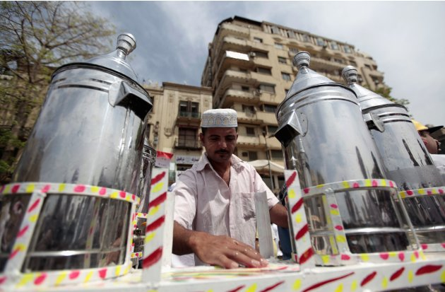 Waleed Ahmed el-Sayed, 31, who received a BA in social services from Assyiut University in 2004, sells juice in Tahrir square in Cairo