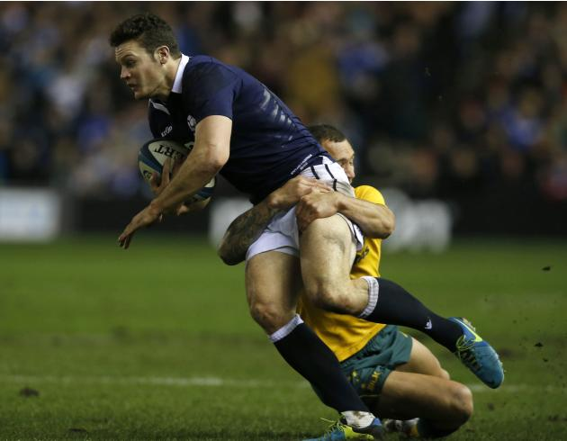 Australia's Quade Cooper tackles Scotland's Duncan Taylor during their rugby union international test match at Murrayfield Stadium in Edinburgh