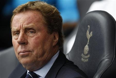 Tottenham Hotspur's Redknapp sits in his chair before the match against the Blackburn Rovers during their English Premier League soccer match at White Hart Lane in London