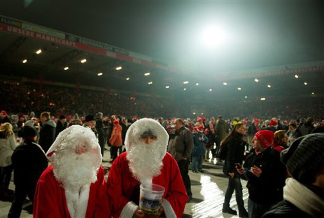 Drink enough mulled wine and you start seeing double Santa (AP)