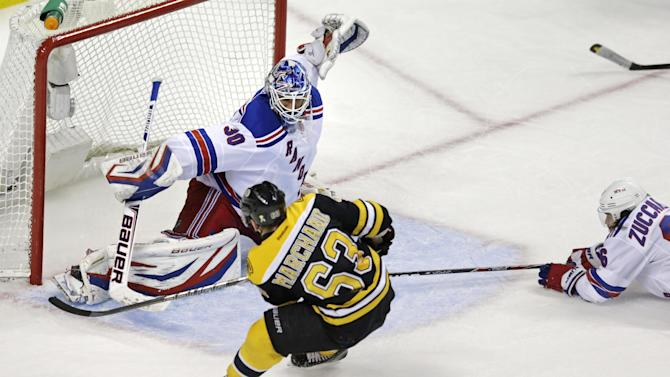 Boston Bruins left wing Brad Marchand (63) beats New York Rangers goalie Henrik Lundqvist (30) for the game-winning goal during overtime in Game 1 of an NHL hockey playoffs Eastern Conference semifinal in Boston, Thursday, May 16, 2013. Rangers right wing Mats Zuccarello (36), right, looks on The Bruins won 3-2. (AP Photo/Charles Krupa)