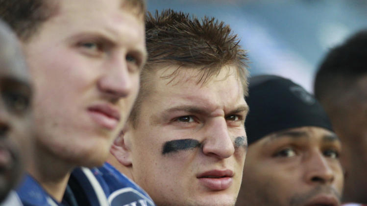 New England Patriots tight end Rob Gronkowski, center, watches from the bench during an NFL football game against the Indianapolis Colts in Foxborough, Mass., Sunday, Dec. 4, 2011. Gronkowski scored three touchdowns in the Patriots' 34-21 victory. (AP Photo/Elise Amendola)