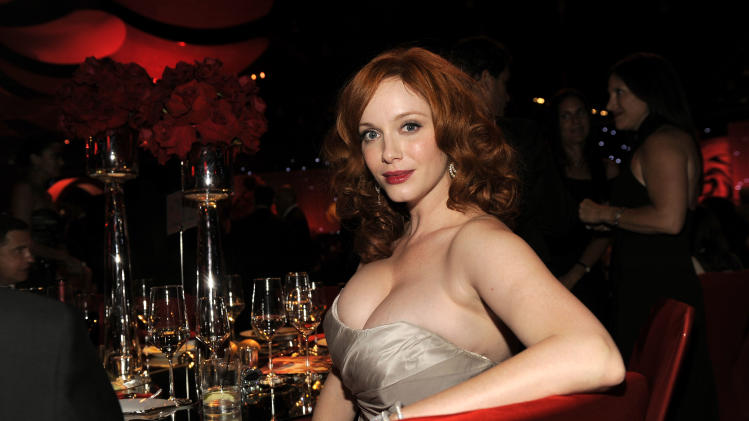 Christina Hendricks poses for a photo at the 64th Primetime Emmy Awards Governors Ball on Sunday, Sept. 23, 2012, in Los Angeles. (Photo by Chris Pizzello/Invision/AP)