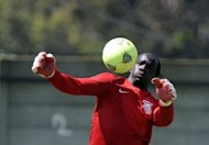 "Zambia goalkeeper Kennedy Mweene at a training session in Johannesburg on Thursday ahead of the Africa Cup of Nations. ""If you look at 2010 there were flags on the roads. This time -- nothing,"" said Christopher Kalibwe, 28, sporting his native Zambia's green, red, black and orange at a warm-up match in Johannesburg."