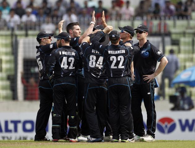 New Zealand's fielders celebrate the dismissal of Bangladesh's Mominul Haque during their first ODI cricket match in Dhaka