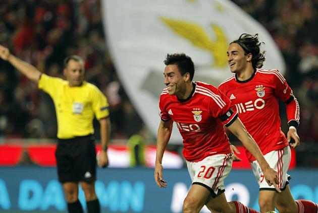 Benfica's Nico Gaitan, from Argentina, celebrates with teammate Lazar Markovic, right, from Serbia, after scoring the opening goal of the game against Sporting during the Portuguese league soccer