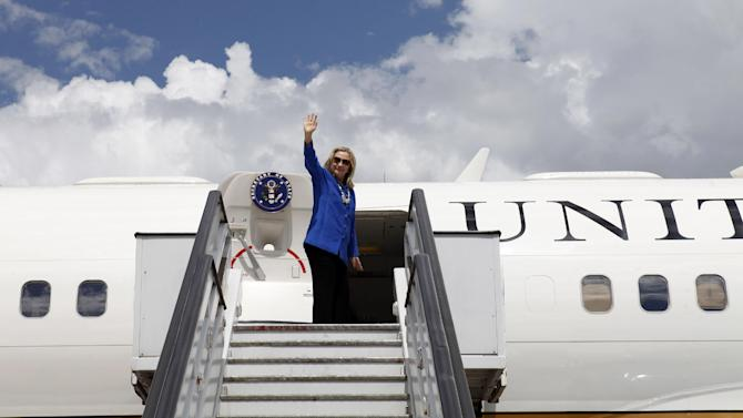FILE - In this April 17, 2012, file photo, Secretary of State Hillary Rodham Clinton waves goodbye before leaving Brasilia, Brazil, en route to Brussels. Clinton's plan for 2013 was simple. She'd embark on an epic swansong around the world as secretary of state, a dizzying itinerary of east-west and north-south flights that would take her past 1 million miles in the air at the helm of American diplomacy and perhaps break her own record of 112 countries visited while in the post. Her health got in the way and she was sidelined by circumstances beyond her control. (AP Photo/Jacquelyn Martin, Pool)
