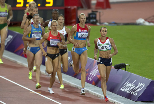 Britain's Jessica Ennis runs towards a gold medal finish in the women's heptathlon event during the London 2012 Olympic Games at the Olympic Stadium August 4, 2012. REUTERS/Neil Hall (BRITAIN - Tags: SPORT OLYMPICS ATHLETICS)
