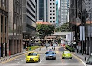 View of a street in Singapore&#39;s financial district in 2009. A wealthy Chinese expatriate who crashed his million-dollar Ferrari into a taxi killing himself and two others has sparked outrage in Singapore, where anti-immigrant sentiment is on the rise