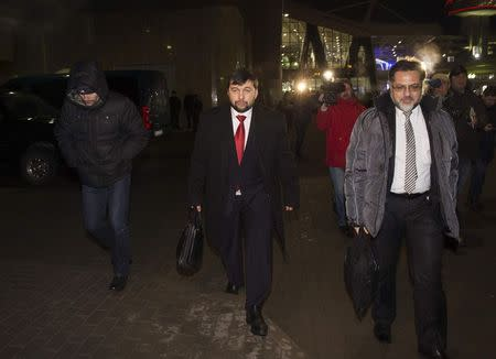 Pushilin, representative of the separatist self-proclaimed Donetsk People's Republic and Deinego, representative of the Luhansk republic walk before leaving Belarus at Minsk's International airport