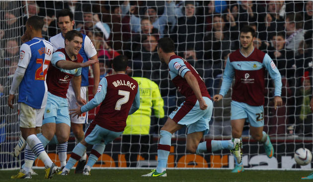 Sam Vokes, second left, celebrates scoring a late equaliser against Blackburn
