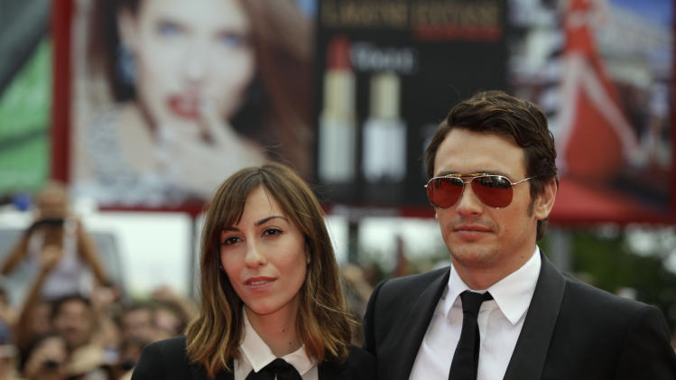 Director Gia Coppola and actor James Franco poses for photographers as she arrives on the red carpet for the film Palo Alto at the 70th edition of the Venice Film Festival held from Aug. 28 through Sept. 7, in Venice, Italy, Sunday, Sept. 1, 2013. (AP Photo/Andrew Medichini)