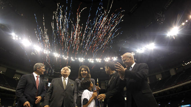 Shaan Jindal, center, son of Louisiana Gov. Bobby Jindal, second from right, watches the pyrotechnics he set off with the plunger to dedicate the newly renovated Louisiana Superdome to kickoff for the NFL Saints football season in New Orleans, Wednesday, Aug. 10, 2011. From left are Doug Thornton, executive vice president of Superdome Management Group, Saints owner Tom Benson, Saints owner and executive vice president Rita Benson LeBlanc and New Orleans Mayor Mitch Landrieu. The $85 million in state-funded upgrades were a key part of the state's agreement with the New Orleans Saints to ensure the team remains in New Orleans through 2025. (AP Photo/Gerald Herbert)