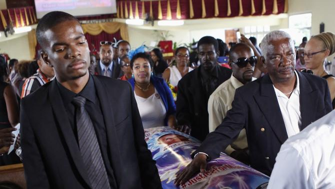 Romon and Nicholas Deane attend the funeral for Mario in Montego Bay