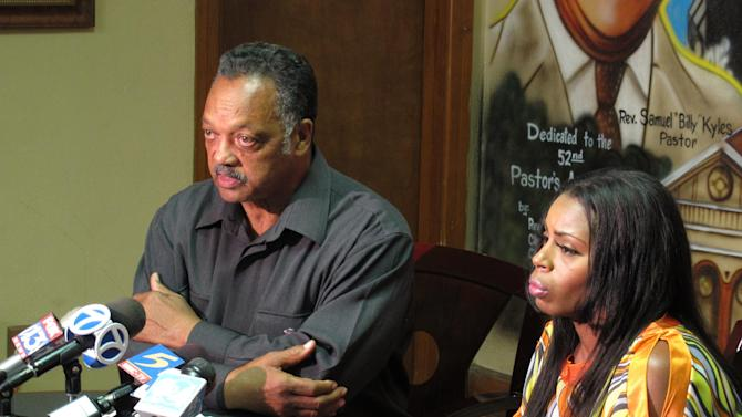 The Rev. Jesse Jackson, left, and Teresa Carter speak during at a news conference at Monumental Baptist Church Wednesday, Aug. 22, 2012 in Memphis, Tenn. about the death of Carter's son, Chavis Carter while he was in police custody in Jonesboro Ark. Jackson is calling on the Justice Department to investigate the death of a 21-year-old man who was shot in the head while handcuffed in the back of a patrol car.  (AP Photo/Adrian Sainz)