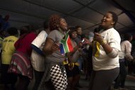 African National Congress (ANC) supporters dance in honour of former South African President Nelson Mandela at the Walter Sisulu University in Mthatha December 14, 2013. REUTERS/Siegfried Modola