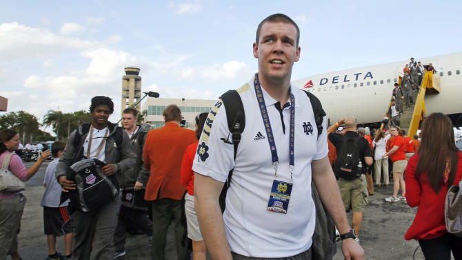 Notre Dame offensive lineman Matt Tansey arrives in Fort Lauderdale, Fla., Wednesday, Jan. 2, 2013. Notre Dame is scheduled to play Alabama in the BCS national championship NCAA college football game next Monday in Miami. (AP Photo/Alan Diaz)