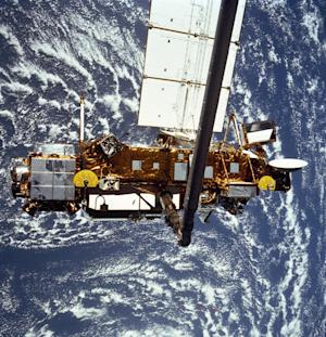 FILE - In this file image provided by NASA this is the STS-48 onboard photo of the Upper Atmosphere Research Satellite (UARS) in the grasp of the RMS (Remote Manipulator System) during deployment, from the shuttle in September 1991. NASA's old research satellite is expected to come crashing down through the atmosphere Friday afternoon, Sept. 23, 2011 Eastern Time. The spacecraft will not be passing over North America then, the space agency said in a statement Wednesday evening. (AP Photo/NASA)