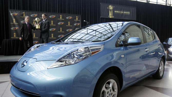 FILE - In this Thursday, April 21, 2011 file photo, the Nissan Leaf is presented as the 2011 World Car of the Year at the New York International Auto Show. Nissan is offering cheap leases and big discounts on the Leaf because of slow sales of the all-electric car, Friday, Sept. 28, 2012. (AP Photo/Richard Drew, File)