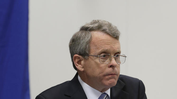 Ohio Attorney General Mike DeWine holds up a report at a news-conference, detailing the lack of proper supervision and failures in the system that led to a chaotic police chase with 13 officers firing 137 rounds, killing two people at the Bureau of Criminal investigation Tuesday, Feb. 5, 2013, in Richfield, Ohio. DeWine released the first detailed account of the Nov. 29, 2012 shooting. He turned it over to the Cuyahoga County prosecutor, who said the case will be presented to a grand jury to determine if the officers should face charges. (AP Photo/Tony Dejak)