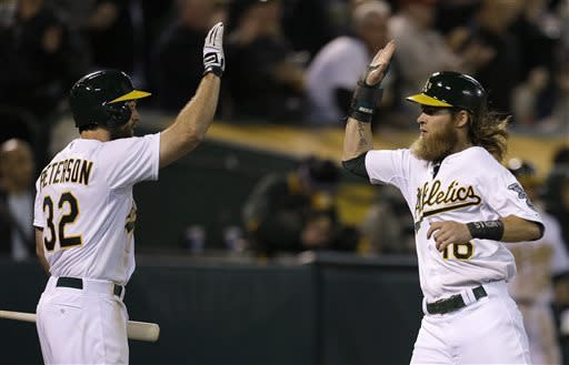 Donaldson's triple lifts A's over Astros 4-3
