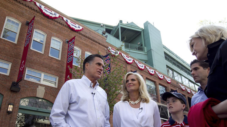 Republican presidential candidate, former Massachusetts Gov. Mitt Romney and his wife Ann, center, speak with ABC newswoman Diane Sawyer, right, at Fenway Park baseball stadium in Boston, Monday, April 16, 2012. (AP Photo/Steven Senne)