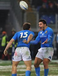 Italy's Tommaso Benvenuti (L) is congratulated by teammate Giovanbattista Venditti after scoring a try during their Six Nations rugby union match between against England at the Olympic Stadium in Rome, on February 11. Italy face Ireland next, on Saturday, in Dublin