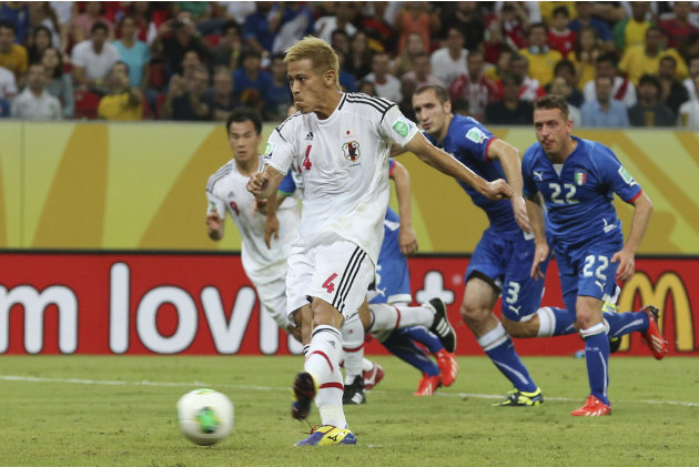 Japan's Keisuke Honda scores the opening goal from the penalty spot during the soccer Confederations Cup group A match between Italy and Japan at the Arena Pernambuco in Recife, Brazil, Wednesday, Jun