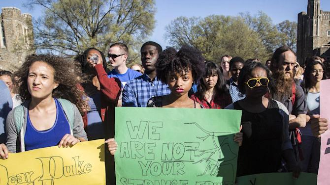 Duke students from left, Michaela Stith, Ashley Croker-Benn and Jasmine Roddey rally during a university-wide forum outside the Duke Chapel on campus Wednesday, April 1, 2015, in Durham, N.C. Duke officials said Wednesday that they are trying to find out who hung a noose outside a building that houses several offices, including those focused on diversity. (AP Photo/The News & Observer, Travis Long) MANDATORY CREDIT