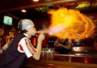 A South Korean bartender creates a ball of flame by spraying alcohol from his mouth in Seoul in 2003. South Korean President Lee Myung-Bak called Tuesday for tough action against alcohol-induced violence in a country where the police and courts have traditionally taken a lenient attitude towards drunken offenders