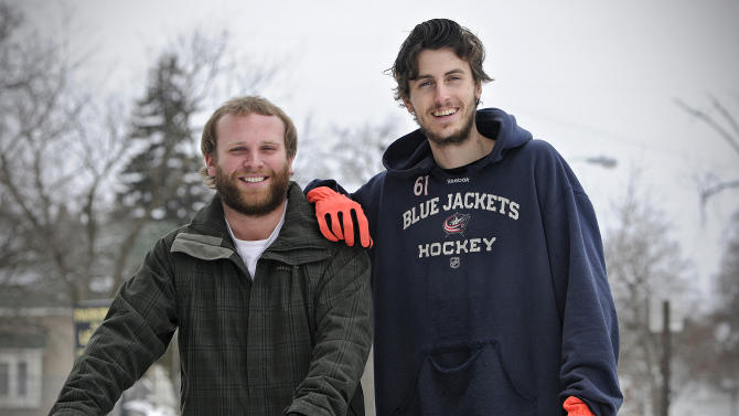 ADVANCED FOR RELEASE MONDAY, MARCH 2, 2015 St. Cloud State students Ryan Brandenburg, left, and Quentin Super plan to ride their bicycles to Winnipeg, Canada, and back over spring break this year. They are pictured in St. Cloud, Minn., Friday, Feb. 20, 2015. (AP Photo/The St. Cloud Times, Dave Schwarz)