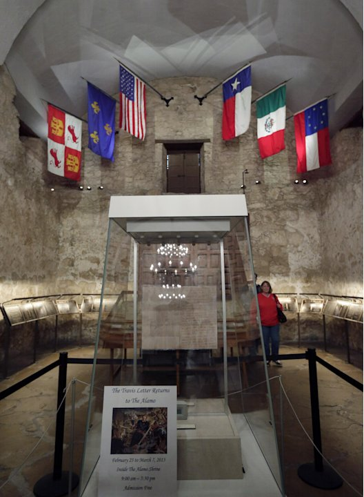 Visitor walk past a custom case that will house Texas hero William Barret Travis'  famed &quot;Victory of Death&quot; letter at the Alamo, Wednesday, Feb. 13, 2013, in Austin, Texas. For the first time in 177 y