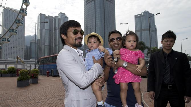 Boxer Manny Pacquiao of the Philippines poses with fans during a promotional event in Hong Kong