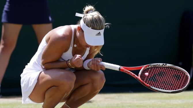 Angelique Kerber of Germany reacts during her match against Garbine Muguruza of Spain at the Wimbledon Tennis Championships in London