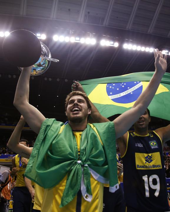 Mossa Rezende of Brazil walks around the court holding a trophy with his teammates to celebrate winning the World Grand Champions Cup in Tokyo
