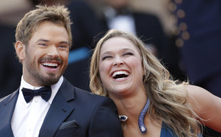 Actor Kellan Lutz, left, and Ronda Rousey, from the movie The Expendables 3, arrive at the Cannes film festival. (AP)