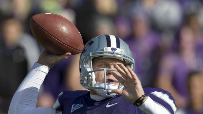 Kansas State quarterback Collin Klein throws a pass during the first half of an NCAA college football game against Texas Tech in Manhattan, Kan., Saturday, Oct. 27, 2012. (AP Photo/Orlin Wagner)