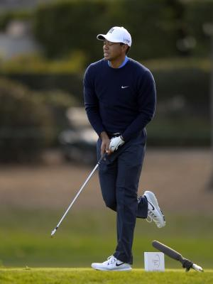 Tiger Woods reacts to his tee shot on the third hole during the first round of the Northwestern Mutual World Challenge golf tournament at Sherwood Country Club, Thursday, Dec. 5, 2013, in Thousand Oaks, Calif. (AP Photo/Mark J. Terrill)