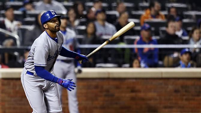 Los Angeles Dodgers' Matt Kemp hits a sixth-inning,two-run home run off New York Mets starting pitcher Matt Harvey in a baseball game at Citi Field in New York, Wednesday, April 24, 2013. (AP Photo/Kathy Willens)