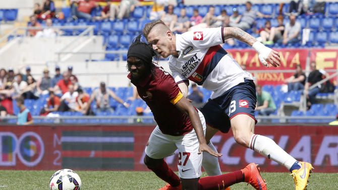 Roma's Gervinho, left, is fouled by Genoa's Jurai Kucka during a Serie A soccer match between Roma and Genoa at Rome's Olympic stadium, Sunday, May 3, 2015. (AP Photo/Riccardo De Luca)