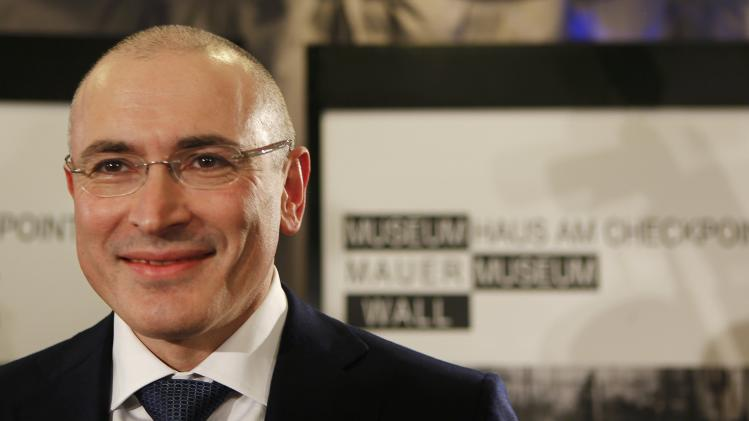 Freed Russian former oil tycoon Khodorkovsky arrives for his news conference in the Museum Haus am Checkpoint Charlie in Berlin