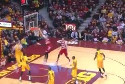 Wisconsin's Sam Dekker levitates for a power slam against Minnesota
