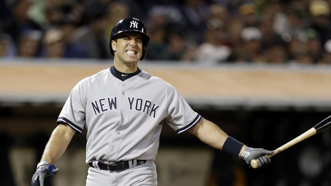 FILE - In this June 11, 2013, file photo, New York Yankees' Mark Teixeira reacts after taking a strike from Oakland Athletics' Jerry Blevins in the eighth inning of a baseball game in Oakland, Calif. Kevin Youkilis needs back surgery and Teixeira returned to the 15-day disabled list Tuesday, June 18, 2013, with an aching right wrist, the latest injury setbacks for the depleted Yankees. (AP Photo/Ben Margot, File)