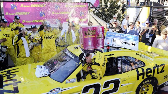 Joey Logano, center, is doused as he and his crew celebrate his win in the NASCAR Nationwide Series auto race, Saturday, Sept. 28, 2013, at Dover International Speedway in Dover, Del. (AP Photo/Nick Wass)