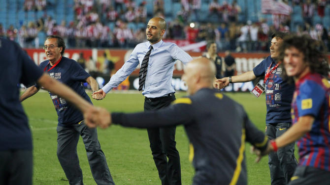 FC Barcelona's coach Josep Guardiola, center, celebrates his team's victory after winning the final Copa del Rey soccer match against Athletic Bilbao at Vicente Calderon stadium in Madrid, Spain, Friday, May 25, 2012. (AP Photo/Andres Kudacki)