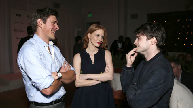 Chris Lowell, Jessica Chastain and Daniel Radcliffe attend at the 6th Annual Women in Film Pre-Oscar cocktail party at Fig and Olive on Friday, Feb. 22, 2013 in Los Angeles. (Photo by Todd Williamson/Invision/AP)