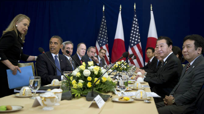 U.S. Secretary of State Hillary Rodham Clinton takes her seat at the beginning of a meeting between U.S. President Barack Obama, second from left, and Japan's Prime Minister Yoshihiko Noda, second from right, during the East Asia Summit at the Peace Palace in Phnom Penh, Cambodia, Tuesday, Nov. 20, 2012. At right is Japan's Economy, Trade and Industry Minister Yukio Edano.  (AP Photo/Carolyn Kaster)