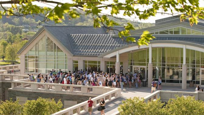 In this May 5, 2010 photo provided by Colgate University, students gather at an end-of-semester event outside the refurbished Case Library and Geyer Center for Information Technology at Colgate University in Hamilton, N.Y. A $480 million fundraising campaign helped pay for this and other projects on Colgate's campus, but possible changes in the tax law could affect donations to higher education. (AP Photo/Colgate University, Andrew M. Daddio)